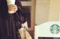 Starbucks in her hand